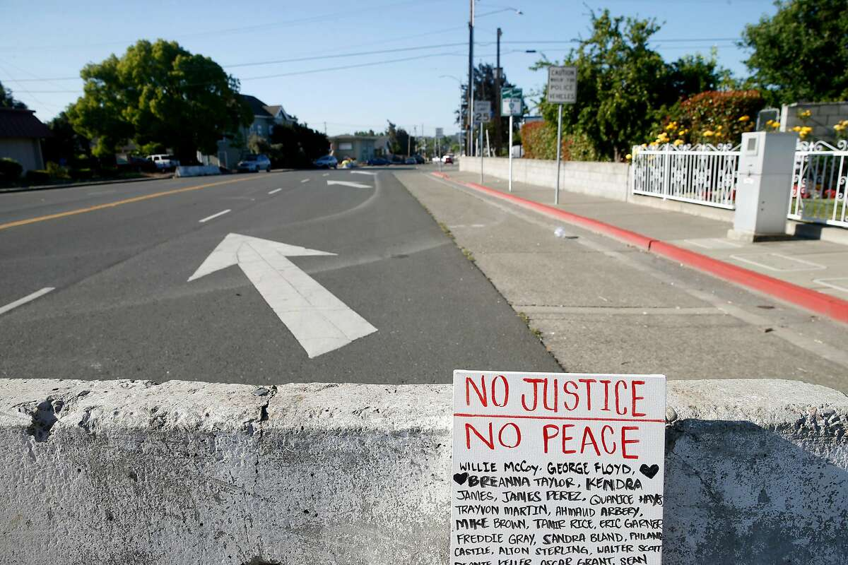 A protester's sign leans against barricades erected to prevent vehicles from driving past the police station in Vallejo, Calif. on Wednesday, June 3, 2020. National Guard troops were deployed in Vallejo Tuesday night as the police station became overwhelmed by crowds massing in the streets.