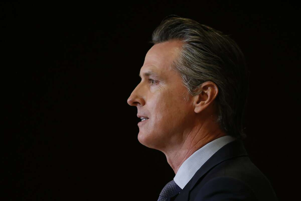 Gov. Gavin Newsom discusses the pain California's black community is feeling Monday, June 1, 2020, over the death of George Floyd, after a meeting with African American leaders in Sacramento, Calif. Newsom urged people to continue expressing themselves through protest, and criticized people who are trying to exploit the protests with violence. Floyd, a black man, died after being restrained by Minneapolis police officers Memorial Day. (AP Photo/Rich Pedroncelli, Pool)