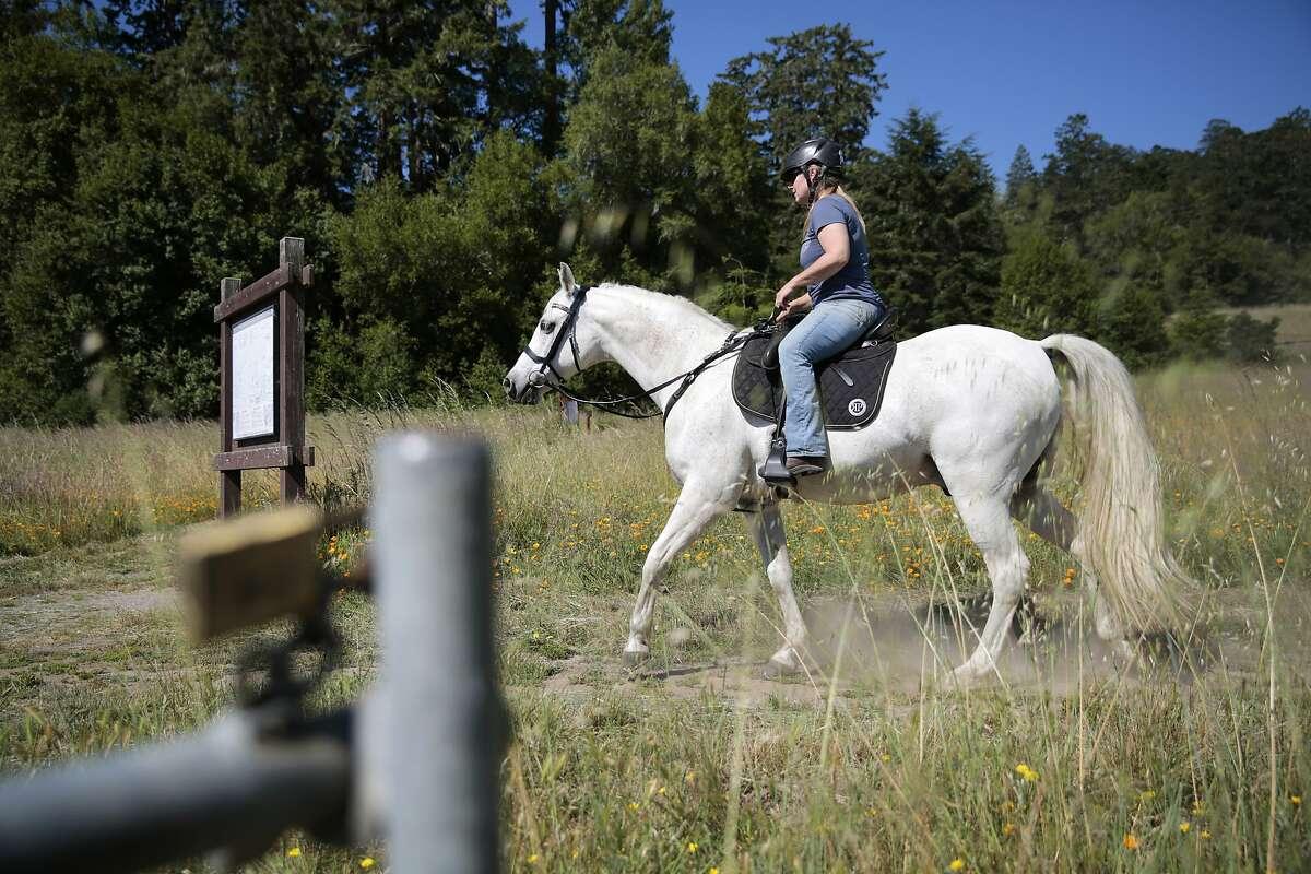 Juli Dell�Era rides her horse Kazanova on the Bear Valley trail in the Point Reyes National Seashore, California, Wednesday, June 3, 2020. Ramin Rahimian/Special to The Chronicle