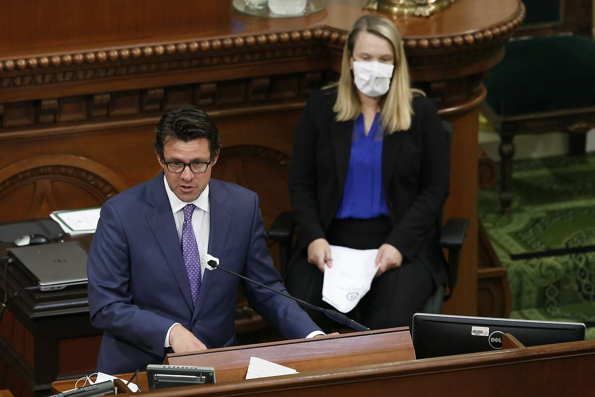 """Legislative Analyst Gabriel Petek, left, discusses Gov. Gavin Newsom's proposed 2020-21 revised state budget during a hearing of the Assembly """"Committee of the Whole on the State Budget,"""" at the Capitol in Sacramento, Calif., Tuesday, May 26, 2020. (AP Photo/Rich Pedroncelli, Pool)"""