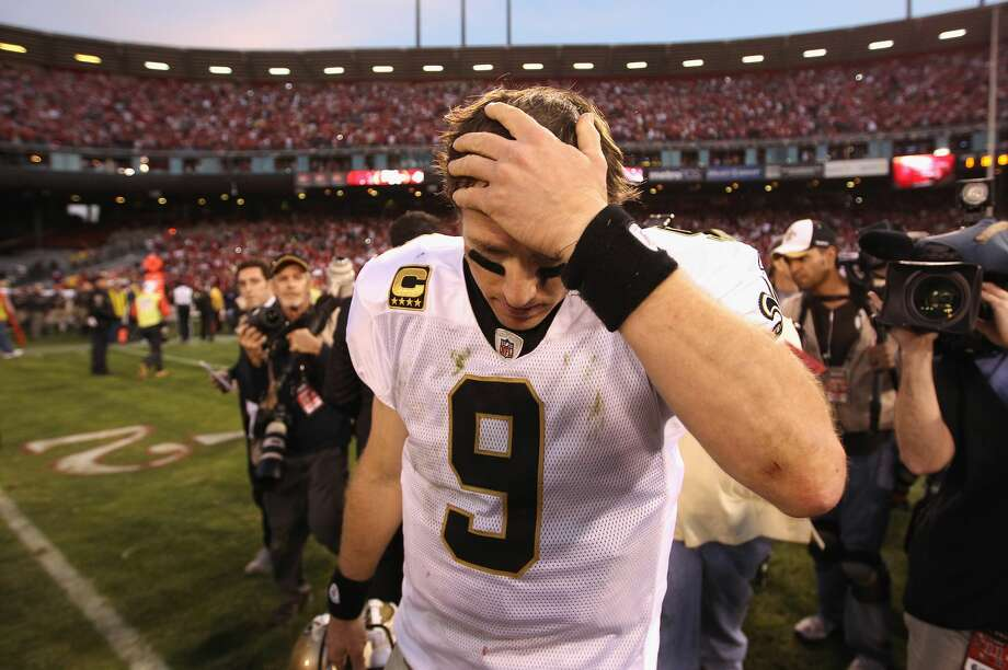 SAN FRANCISCO, CA - JANUARY 14: Drew Brees #9 of the New Orleans Saints reacts after they lost their game against the the San Francisco 49ers in the NFC Divisional playoff game at Candlestick Park on January 14, 2012 in San Francisco, California. (Photo by Ezra Shaw/Getty Images) Photo: Ezra Shaw/Getty Images / 2012 Getty Images