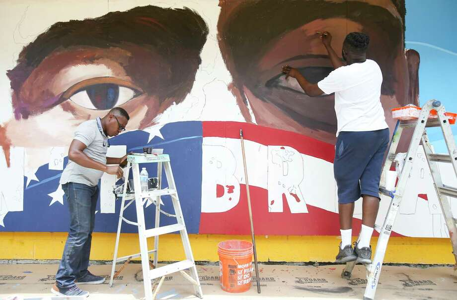 Artists Samson Adenugba, left, and Matthew Jeanbaptiste work on a mural inspired by George Floyed, on the side of the Breakfast Klub in Midtown on Tuesday, June 2, 2020. Photo: Elizabeth Conley, Staff Photographer / © 2020 Houston Chronicle