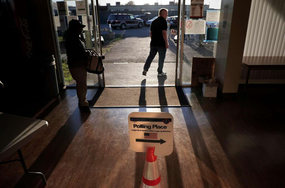 Bryn Smith, polling inspector for the Shipshape Community Center voting location, Treasure Island's only polling location, walks outside during a lull in voting during the mid afternoon in San Francisco, Calif., on Tuesday, November 6, 2018.