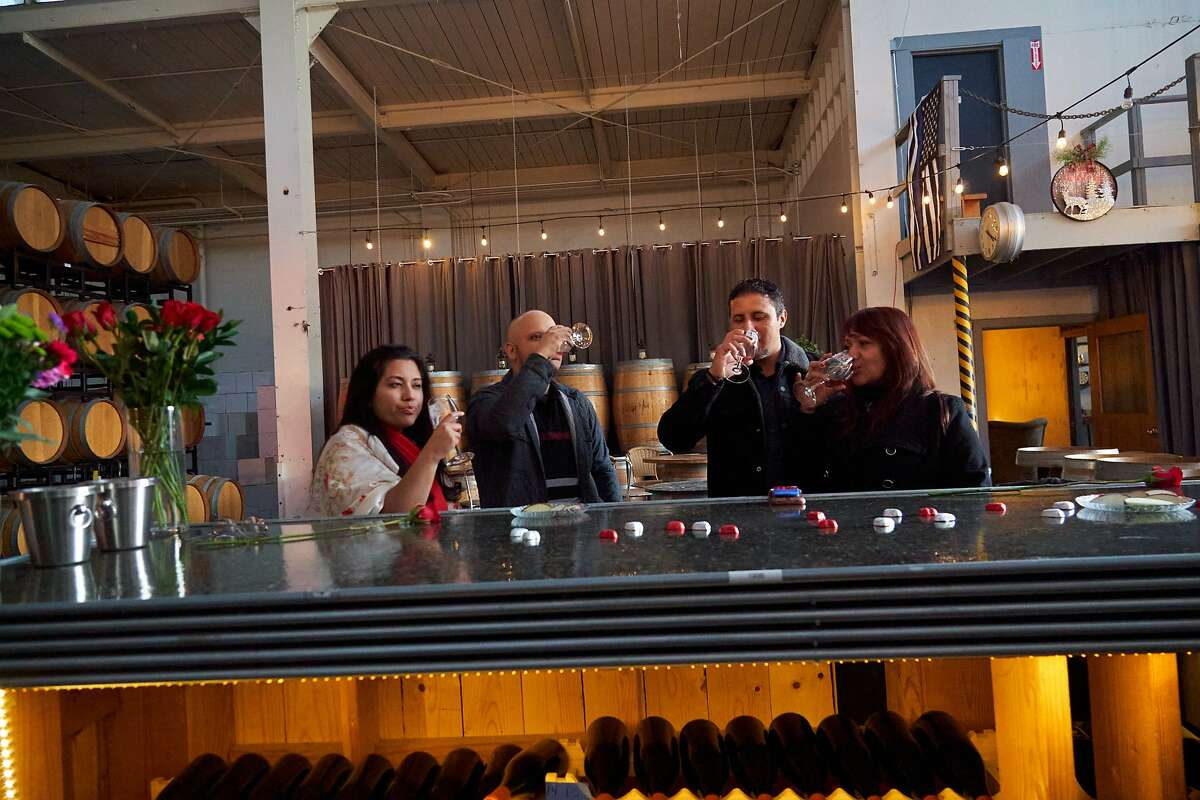 From left, Claudia and Gustavo Islas and Alberto and Gina Islas taste wine at the Building 43 Winery on Saturday, Feb. 15, 2020, in Alameda, Calif.