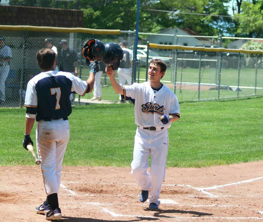 Lucas Weinert crosses home plate after hitting a home run for the Manistee Saints last season. The Saints will open their season at Reitz Park on June 13. (News Advocate file photo)