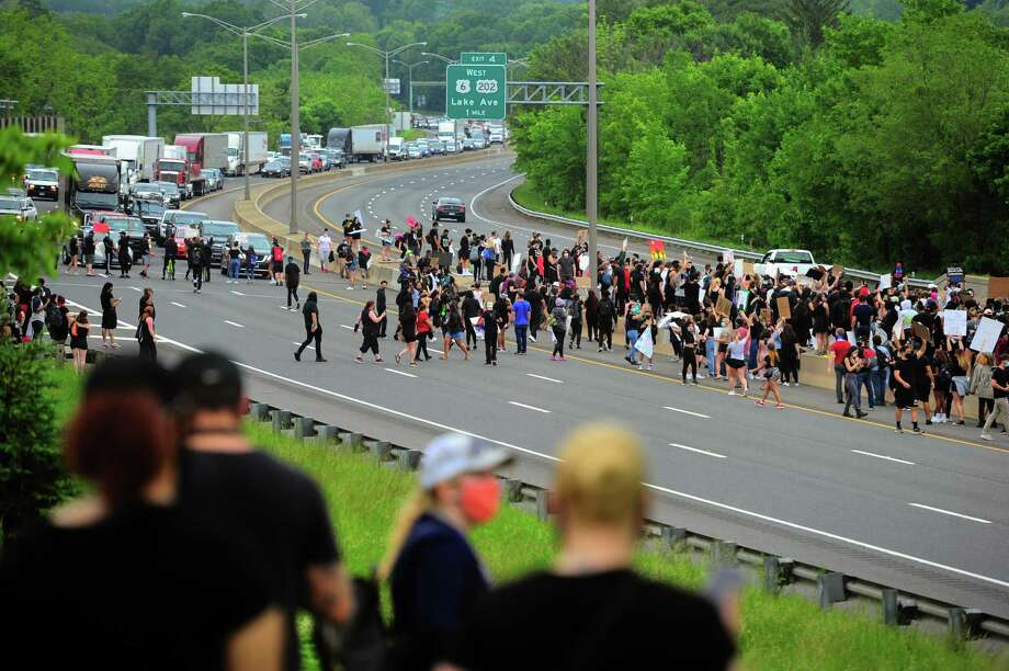 Hundreds of demonstrators run out onto I84 to protest police brutality in Danbury, Conn., on Wednesday June 3, 2020. The protest was one of dozens all over the country after the death of George Floyd in Minneapolis. Photo: Christian Abraham / Hearst Connecticut Media / Connecticut Post