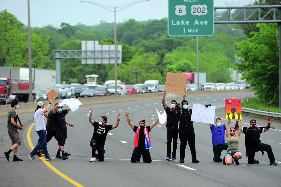 Demonstrators hold up traffic in both directions on I84 to rotest police brutality in ffront of the police station in Danbury, Conn., on Wednesday June 3, 2020. The protest was one of dozens all over the country after the death of George Floyd in Minneapolis.