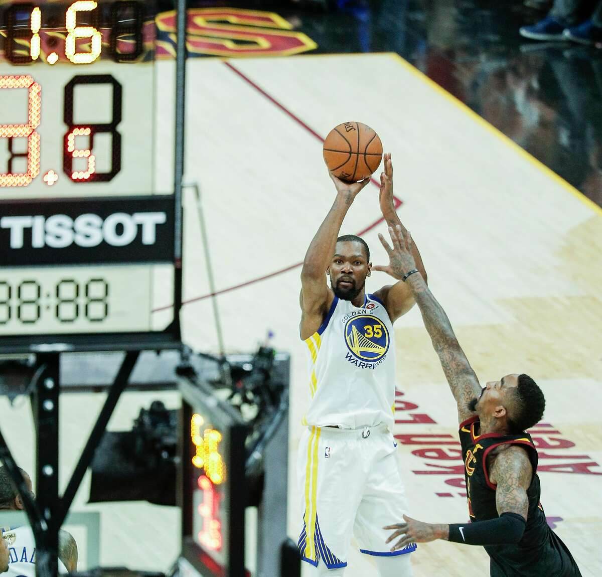 Golden State Warriors' Kevin Durant shoots a three-pointer over Cleveland Cavaliers' JR Smith in the fourth quarter during game 3 of The NBA Finals between the Golden State Warriors and the Cleveland Cavaliers at Oracle Arena on Wednesday, June 6, 2018 in Cleveland, Ohio.
