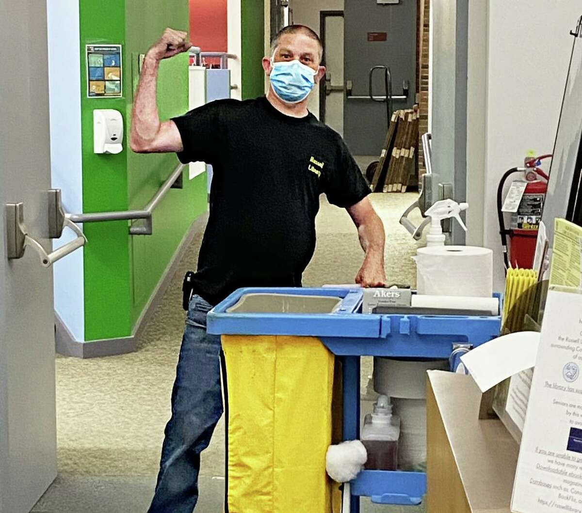 Russell Library custodian Jon Miller cleans the facility in preparation for the eventual return of patrons once the library is deemed safe to reopen amid the COVID-19 outbreak.