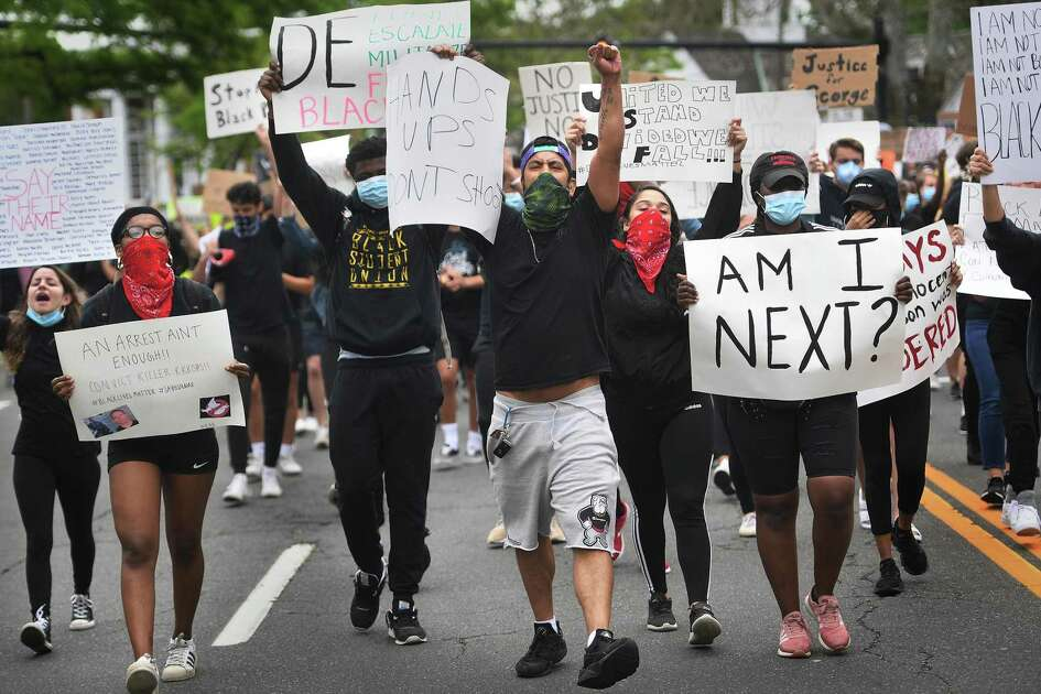 Protestors chant slogans while marching down the Post Road during an organized Black Lives Matter police brutality protest in Fairfield, Conn. on Tuesday, June 2, 2020.