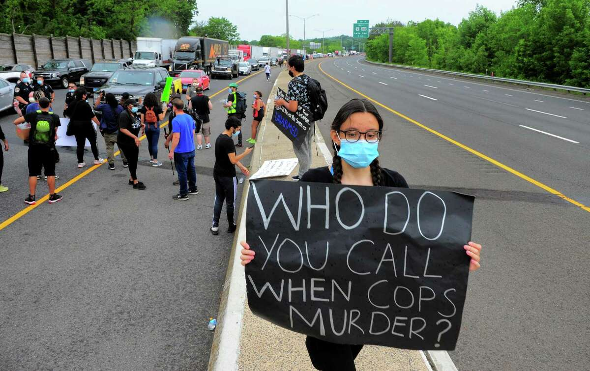 Demonstrators hold up traffic in both directions on Interstate 84 to protest police brutality in front of the police station in Danbury on Wednesday. The protest was one of dozens all over the country after the death of George Floyd in Minneapolis.
