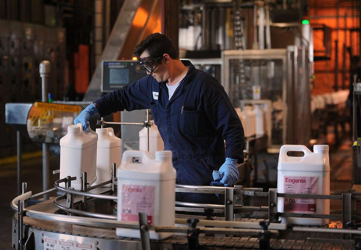 An employee works Tuesday in the packing area of BASF's new dicamba manufacturing facility on West Port Arthur Road. Photo taken Guiseppe Barranco/The Enterprise
