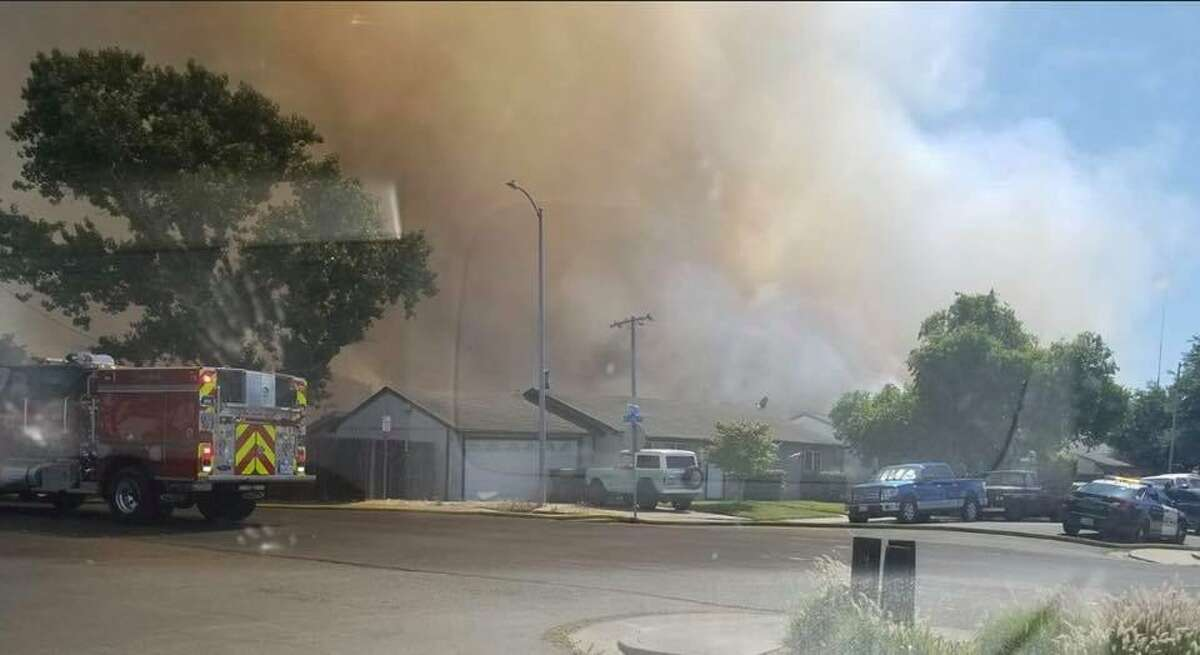 Firefighters are working to put out a brush fire in Suisun City that is forcing an evacuation of nearby homes.