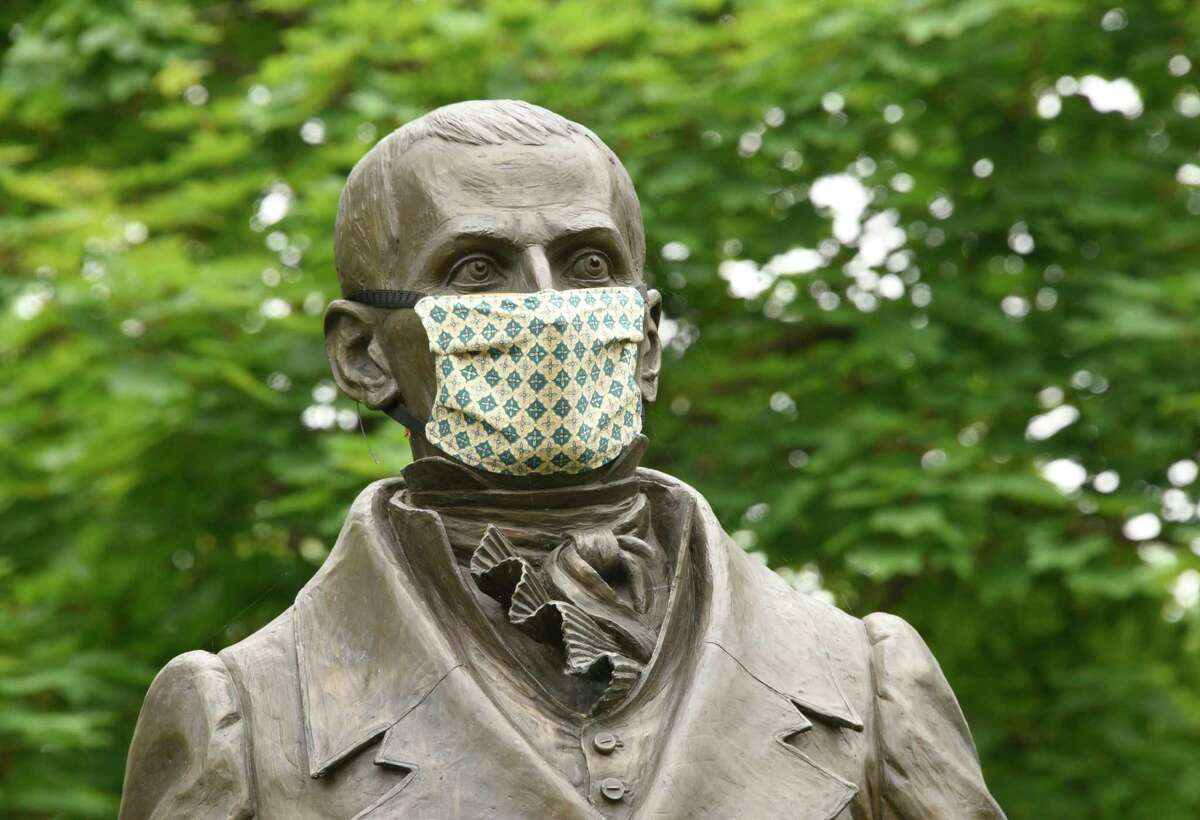 A face mask is seen on the Colonel Albert Pawling statue in Pawling Park on Wednesday, June 3, 2020 in Troy N.Y. Pawling was the first mayor of Troy. (Lori Van Buren/Times Union)