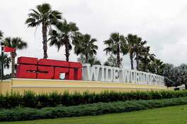 A sign marking the entrance to ESPN's Wide World of Sports at Walt Disney World is seen Wednesday, June 3, 2020, in Kissimmee, Fla. The NBA has told the National Basketball Players Association that it will present a 22-team plan for restarting the season at Disney. (AP Photo/John Raoux)
