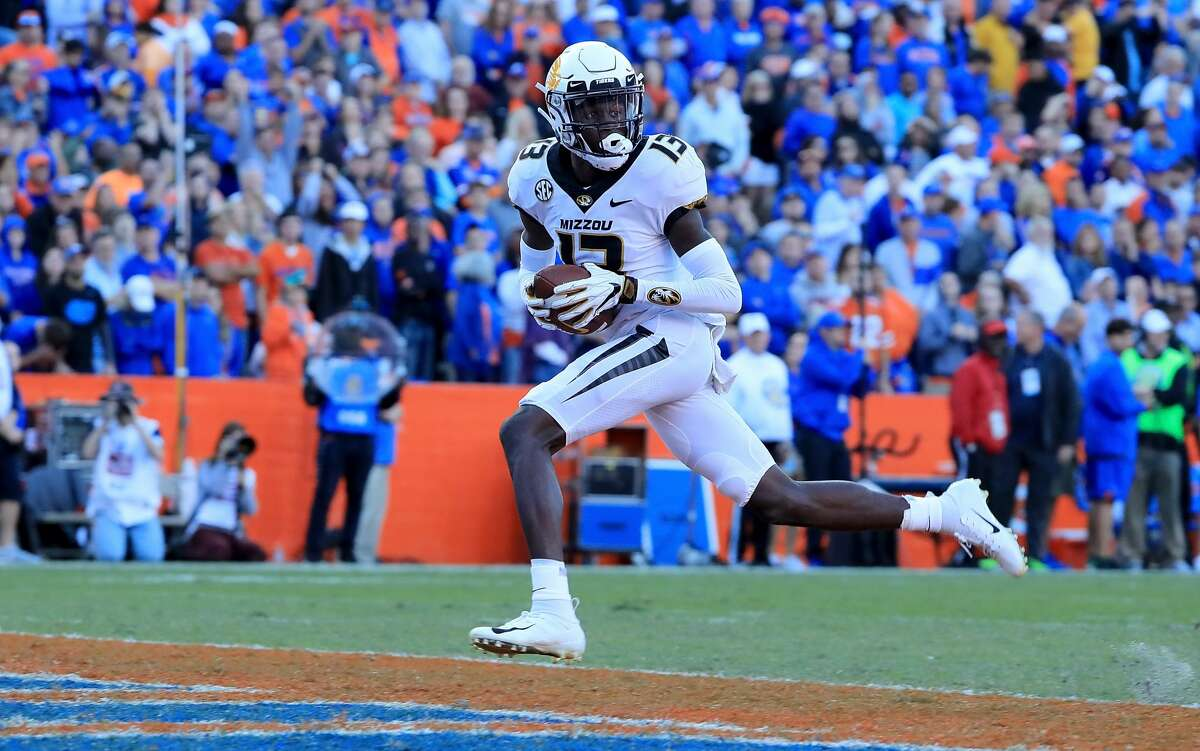 GAINESVILLE, FL - NOVEMBER 03: Kam Scott #13 of the Missouri Tigers crosses the goal line for a touchdown during the game against the Florida Gators at Ben Hill Griffin Stadium on November 3, 2018 in Gainesville, Florida. (Photo by Sam Greenwood/Getty Images)