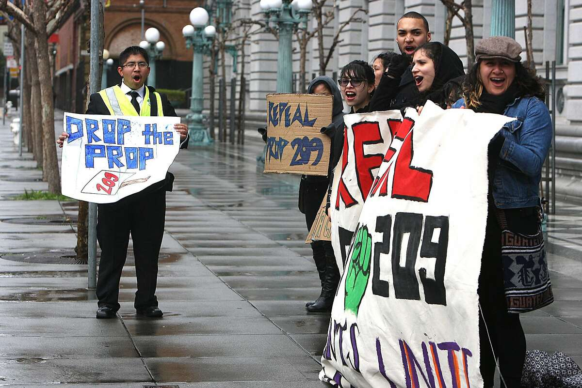 UC Berkeley students Juan M. Heredia (left) and Carolyn Vera(right) protesting in front of the Ninth U.S. Circuit Court of Appeals in San Francisco, Calif., on Monday, February 13, 2011. The court is hearing a new lawsuit challenging Proposition 209, the 1996 initiative that banned affirmative action based on race or sex in state and local government employment and education.