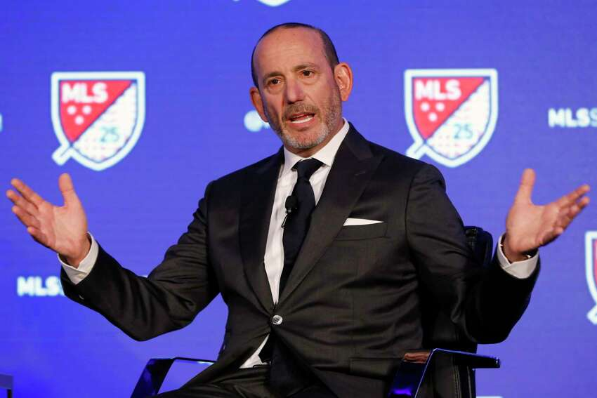 FILE - In this Feb. 26, 2020, file photo, Major League Soccer Commissioner Don Garber speaks during the leagues 25th Season kickoff event in New York. Major League Soccer and its players' union reached an agreement that paves the way for a summer tournament in Florida after the season was suspended by the coronavirus pandemic. The deal was announced by the Major League Soccer Players Association early Wednesday, June 3, 2020, following tense talks that led to some players skipping voluntary workouts and the league threatening a lockout.(AP Photo/Richard Drew, File)