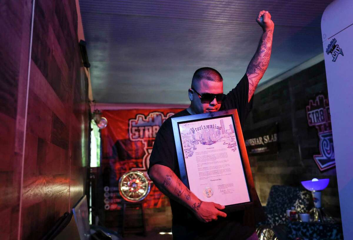Domingo Herrera, who goes by CANDYMAN, poses with proclamation he previously received from the City of Houston during a portrait session Wednesday, June 3, 2020, at his home in Houston. Herrera was arrested Friday, May 29 while protesting in downtown Houston.