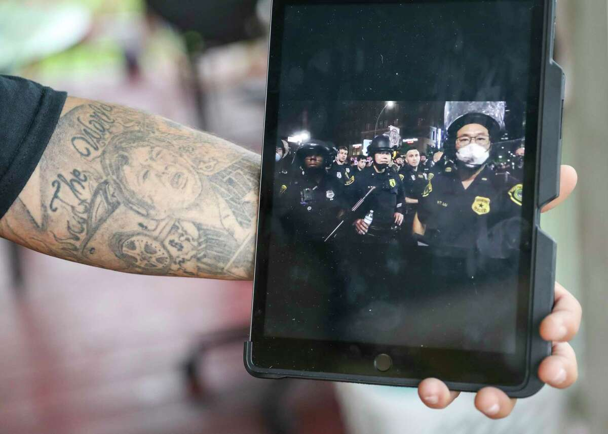 Domingo Herrera, who goes by CANDYMAN, shows a video he recorded while he was being arrested Wednesday, June 3, 2020, at his home in Houston. Herrera was arrested Friday, May 29 while protesting in downtown Houston.