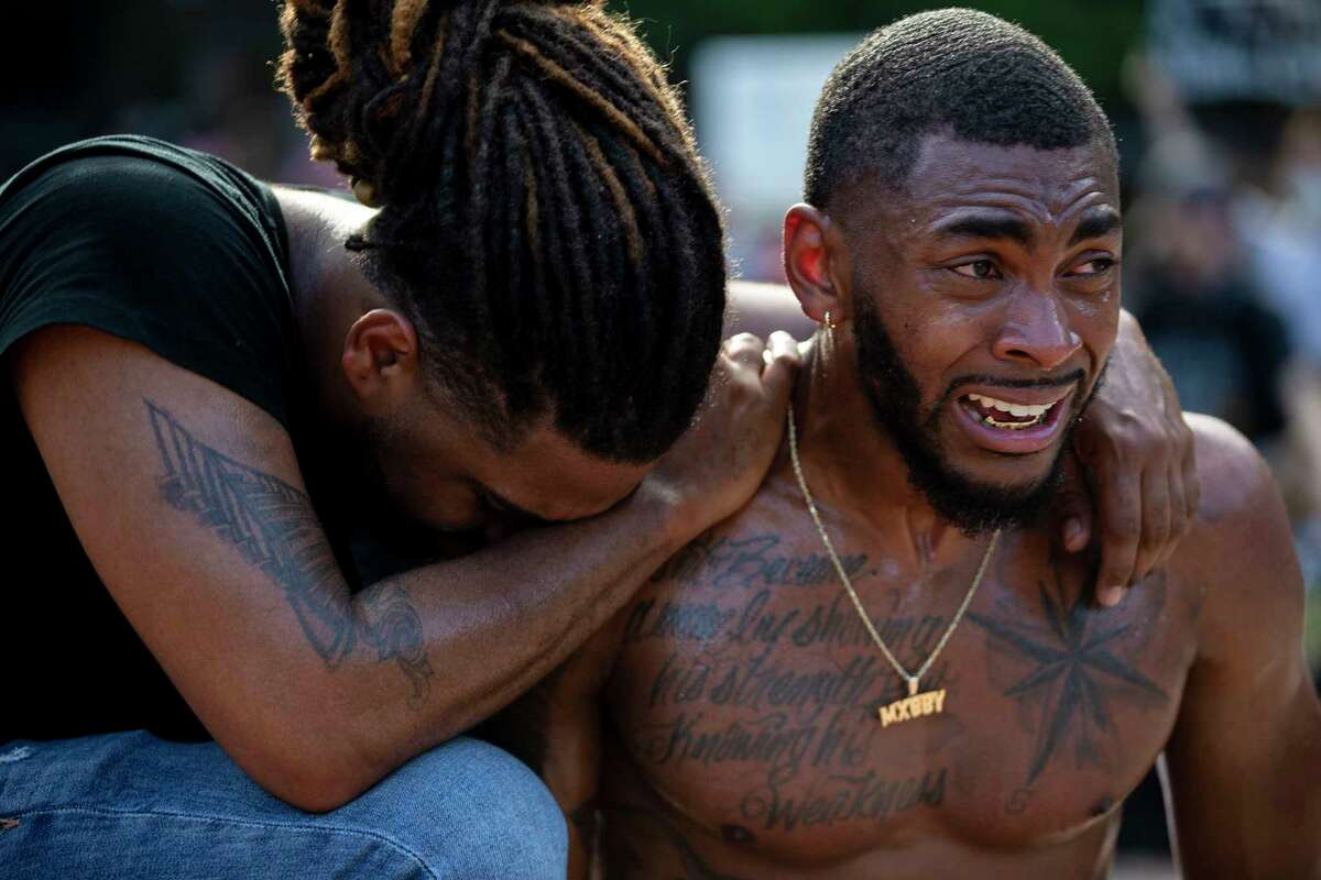 Antonio Lee comforts Trevor Taylor during an emotional moment during a demonstration at Travis Park in downtown San Antonio, Texas, on June 3, 2020. This is the fourth day of protests in San Antonio in the wake of the police killing of George Floyd one week ago in Minneapolis.
