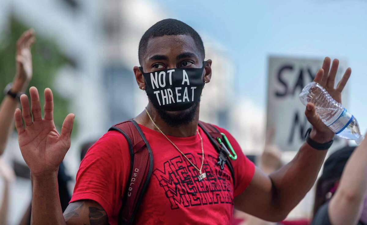 A person protesting the death of George Floyd marches Wednesday, June 3, 2020, around the county courthouse in downtown San Antonio. Floyd died in police custody May 25, 2020 in Minneapolis, Minnesota after a police officer was seen kneeling on his neck for more than 8 minutes. The death has sparked nationwide protests.