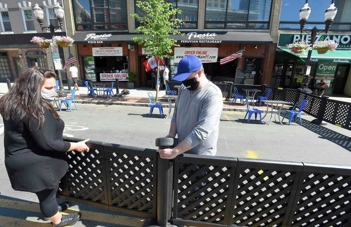 Area restaurants on Main Street in Stamford get ready to transform into outdoor eateries on May 30. Restaurants in Connecticut were allowed to reopen with restrictions on June 1.