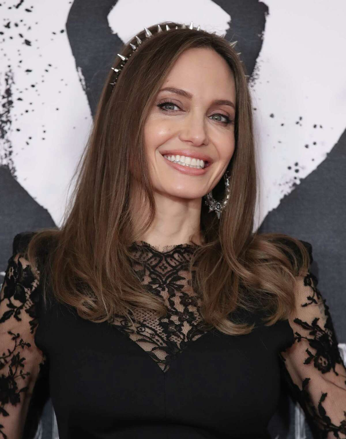 LONDON, ENGLAND - OCTOBER 10: Angelina Jolie attends a photocall for