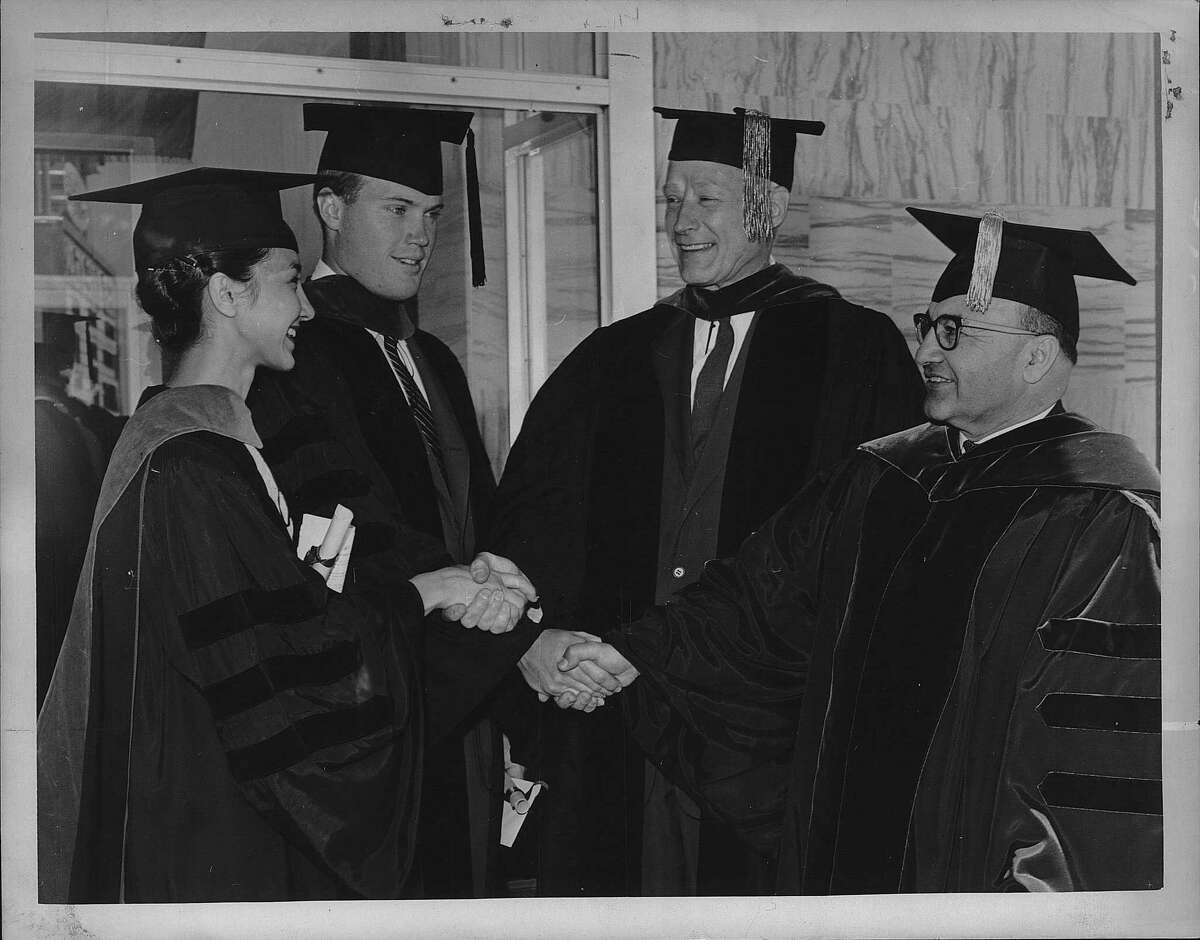 Albany Medical College's 133rd commencement, in June 1962, looks like a family affair as the Albany Medical Center Hospital director, Dr. Thomas Hale, second from right, congratulates his daughter-in-law and son after their medical degrees were awarded. From left are Dr. Cynthia Berberian Hale, Dr. Thomas Hale Jr., Dr. Hale and Dr. Dieram A. Berberian, (Dr. Cynthia Hale's father). (Knickerbocker News Staff Photo/Times Union Archive)