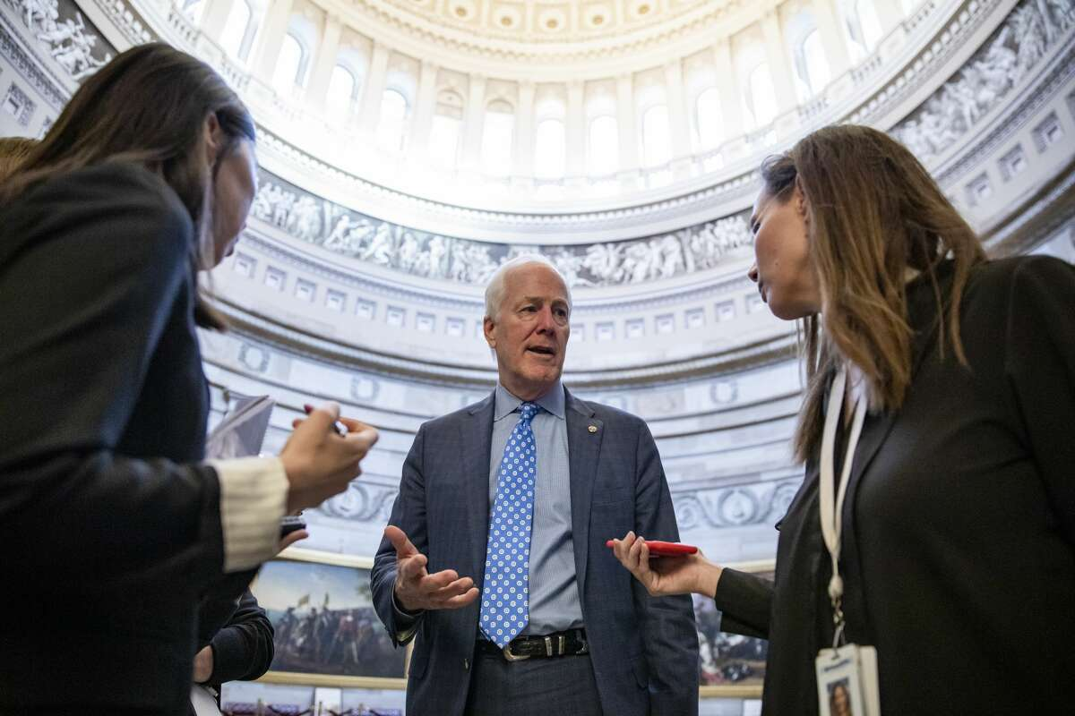WASHINGTON, DC - JANUARY 28: Senator John Cornyn (R-TX) speaks to reporters in the Capitol Rotunda after leaving meeting where Senate Republicans gathered immediately following the conclusion of President Donald Trumps defense teams argument on the seventh day of the Senate impeachment trial of the President on January 28, 2020 in Washington, DC. President Donald Trump's legal defense team concluded their arguments today and the proceedings will continue with written questions from Senators on Wednesday. (Photo by Samuel Corum/Getty Images)