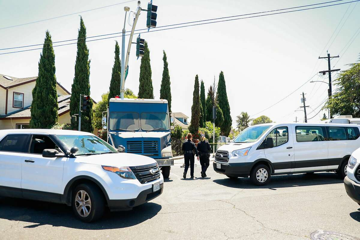 Police officers at the scene where a man reportedly was holding two children hostage on Wednesday, June 3, 2020 in Oakland,California.