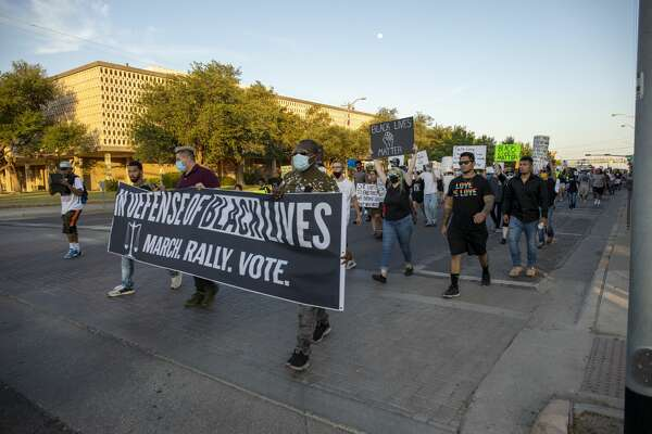 """?""""In Defense of Black Lives?• rally attendees walk in front of the Ector County Courthouse on Wednesday, June 3, 2020 at the corner of Grant Sweet and East 4th Street."""