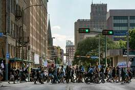 People protesting the death of George Floyd march Wednesday, June 3, 2020, toward Travis Park in downtown San Antonio. Floyd died in police custody May 25, 2020 in Minneapolis, Minnesota after a police officer was seen kneeling on his neck for more than 8 minutes. The death has sparked nationwide protests.