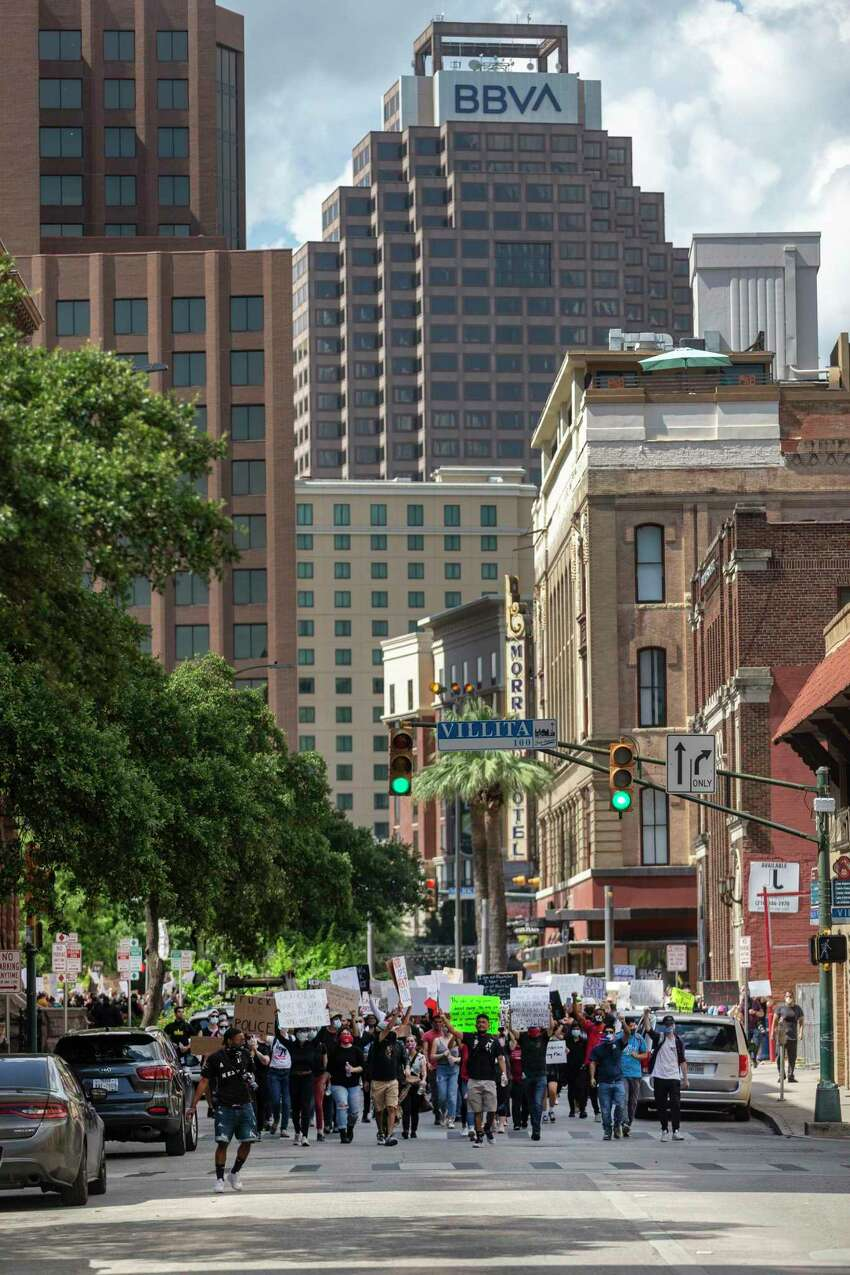 People protesting the death of George Floyd march Wednesday, June 3, 2020, around the county courthouse in downtown San Antonio. Floyd died in police custody May 25, 2020 in Minneapolis, Minnesota after a police officer was seen kneeling on his neck for more than 8 minutes. The death has sparked nationwide protests.