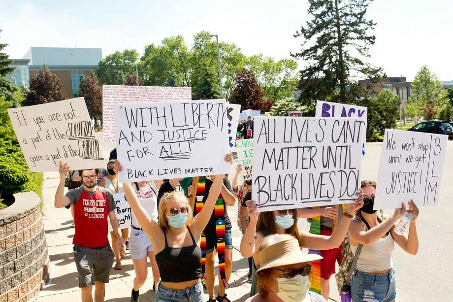 Ferris State's campus was crowded for the first time in months Wednesday afternoon as over 400 came out to peacefully protest in support of the Black Lives Matter movement. The protest was lead by Ferris State student Byron Brooks. During the nearly two-hour protest, a number of speakers — including law enforcement, city officials and students — shared their views surrounding George Floyd's recent death. Photo: Amanda Greenwood / Copyright2016 All rights reserved.