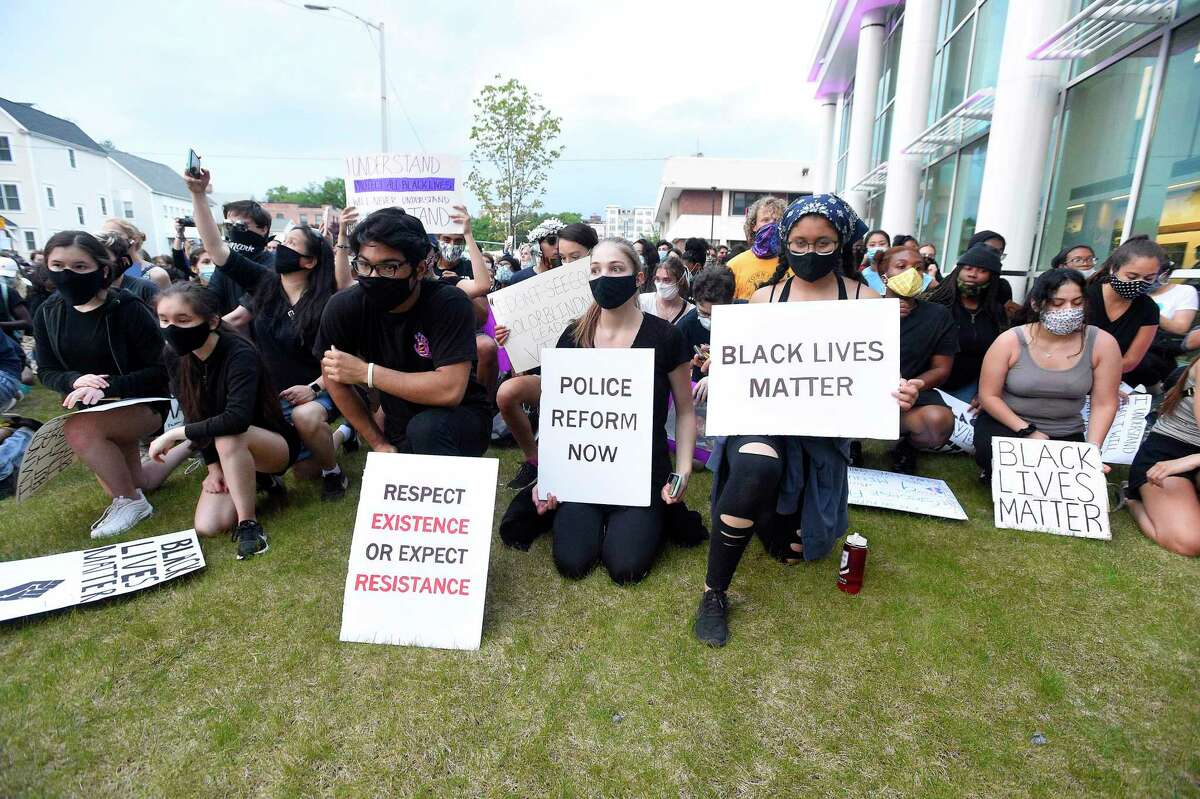 """Protesters shout """"I Can't Breathe"""" as they march on June 3, 2020 from Stamford, Connecticut's Scalzi Park to Columbus Park pausing for prayer then continuing on to the Stamford Police Station holding a peaceful protest calling for justice in the senseless death of George Floyd. Over a thousand protesters took part in the event."""