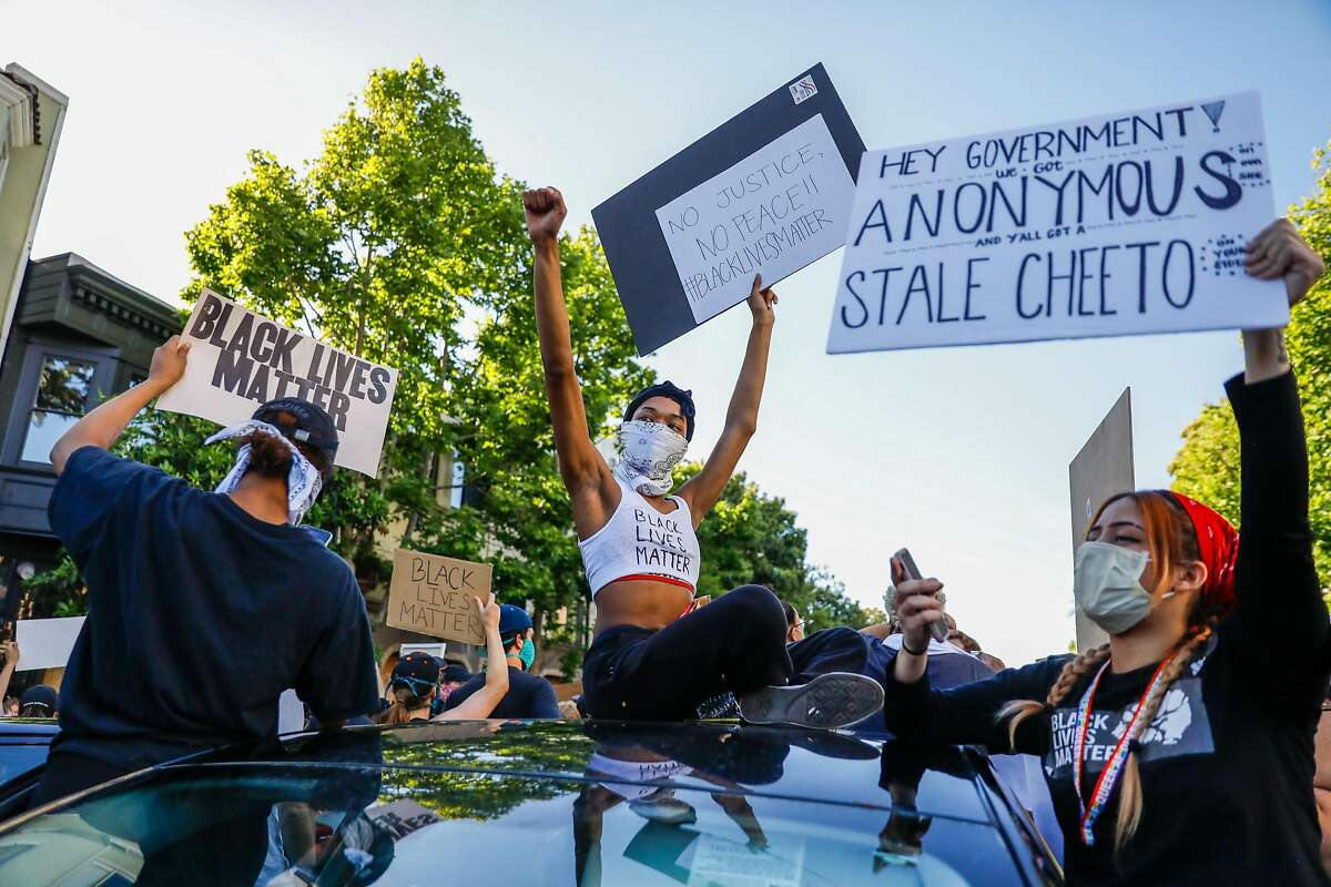 Angel Amourl (center) puts her fist in the air during a student led protest following the death of George Floyd who was killed by police in Minnesota on Wednesday, June 3, 2020 in San Francisco, California.
