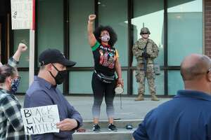 Sarah Speaks, of Vallejo stands in front of members of the California National Guard in Valeljo, Calif. after several tense nights in the wake of the death of Minnesota's George Floyd and a fatal police shooting locally, June 3, 2020.