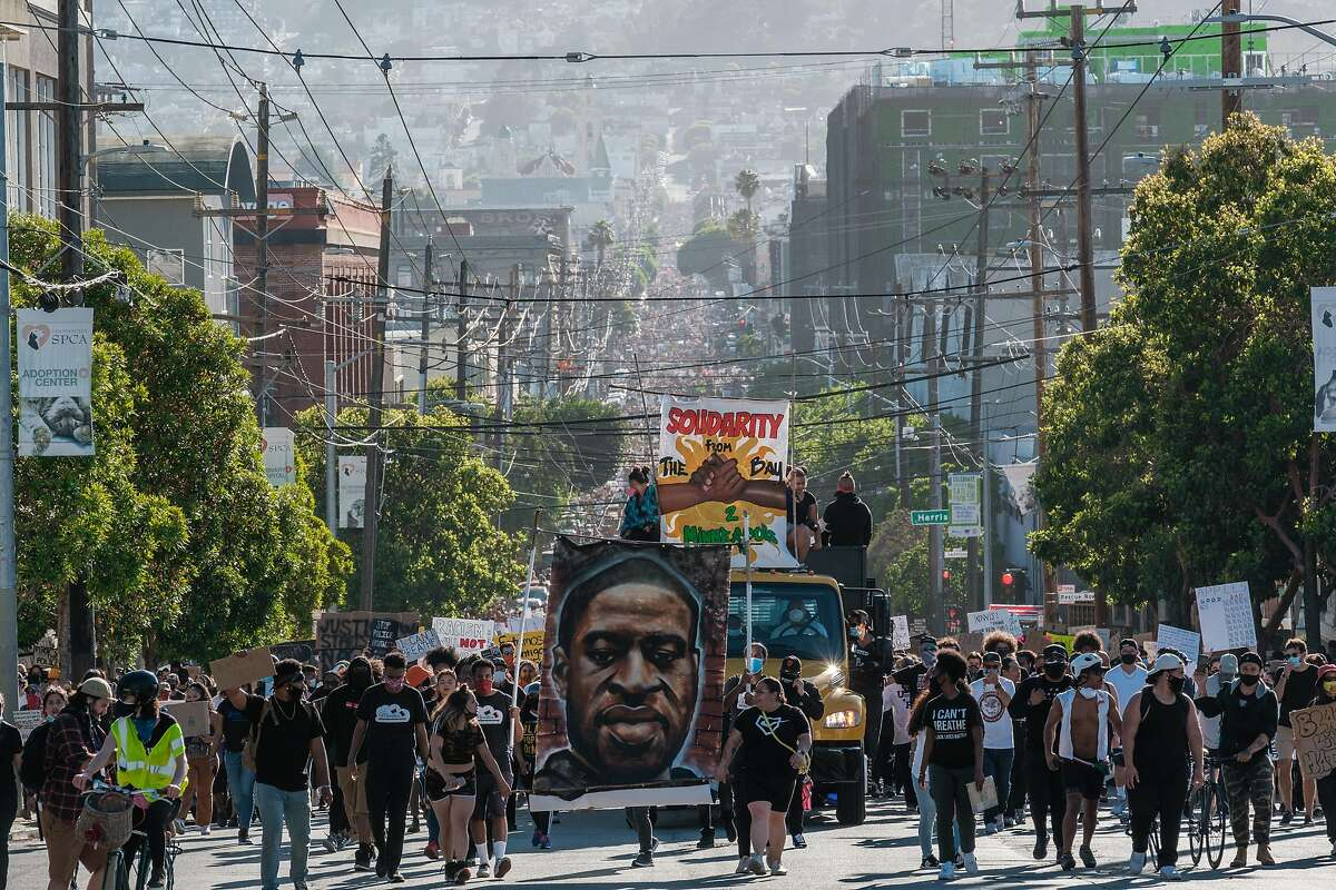 People march in a student led George Floyd protest in San Francisco on Wednesday, June 3, 2020.