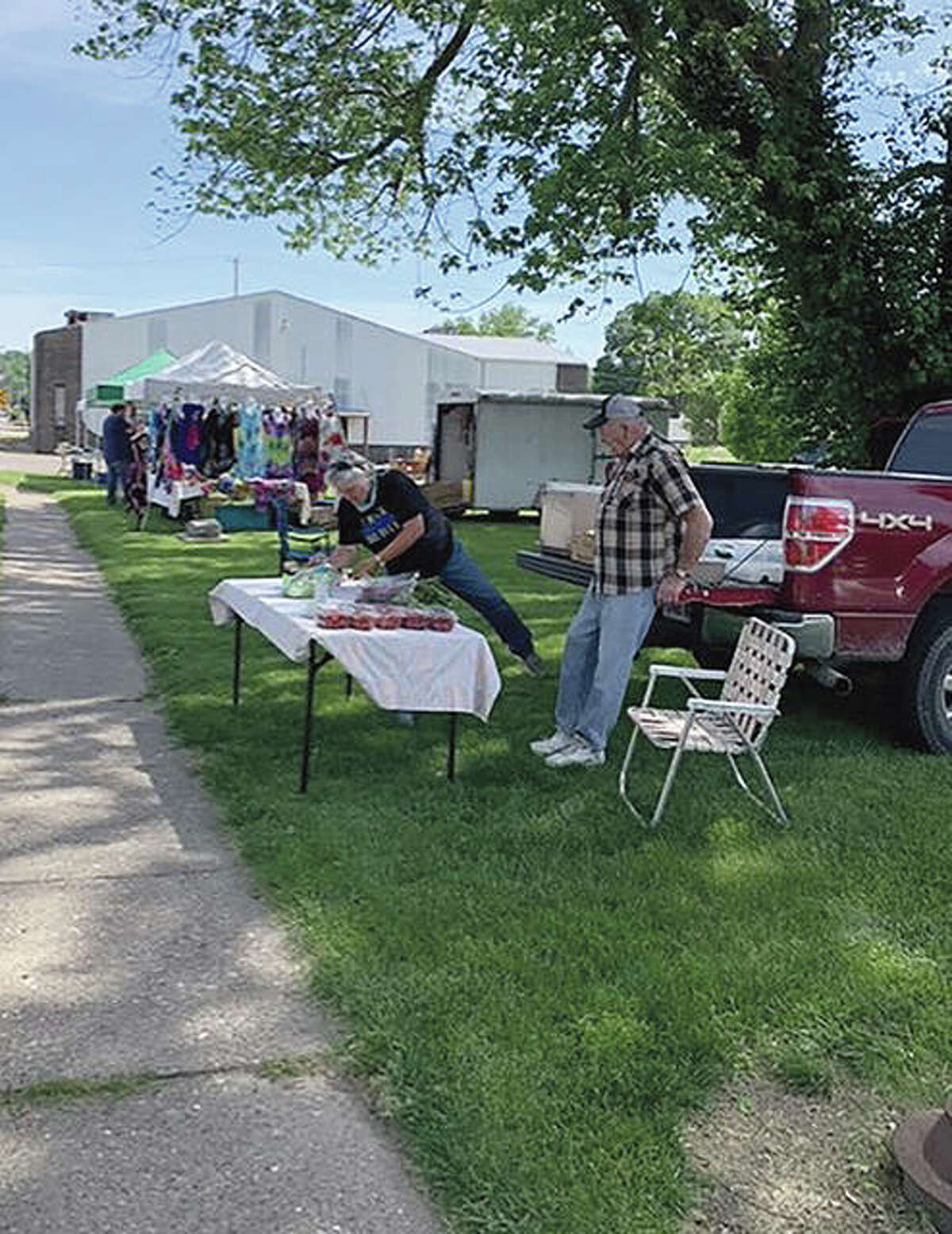 Vendors get ready for the start of the summer market in Bluffs' downtown park. The market is open from 4 to 6 p.m. Tuesdays in June and July and includes homegrown vegetables and other items. Musician Robert Sampson is performing during the market in June.