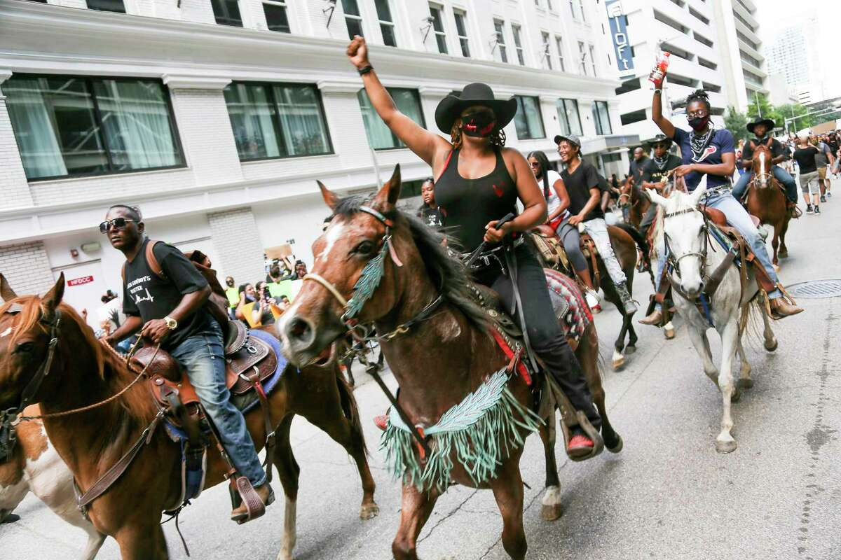 Members of the Nonstop Riders make their way on Walker Street during a march in honor of George Floyd on Tuesday, June 2, 2020, from Discovery Green to City Hall in downtown Houston.