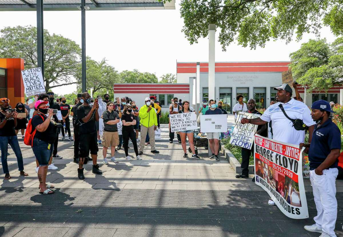 People listen during a rally inspired by Houston native George Floyd, who died in custody of the Minneapolis police earlier this week, during a rally Saturday, May 30, 2020, at Emancipation Park in Houston.
