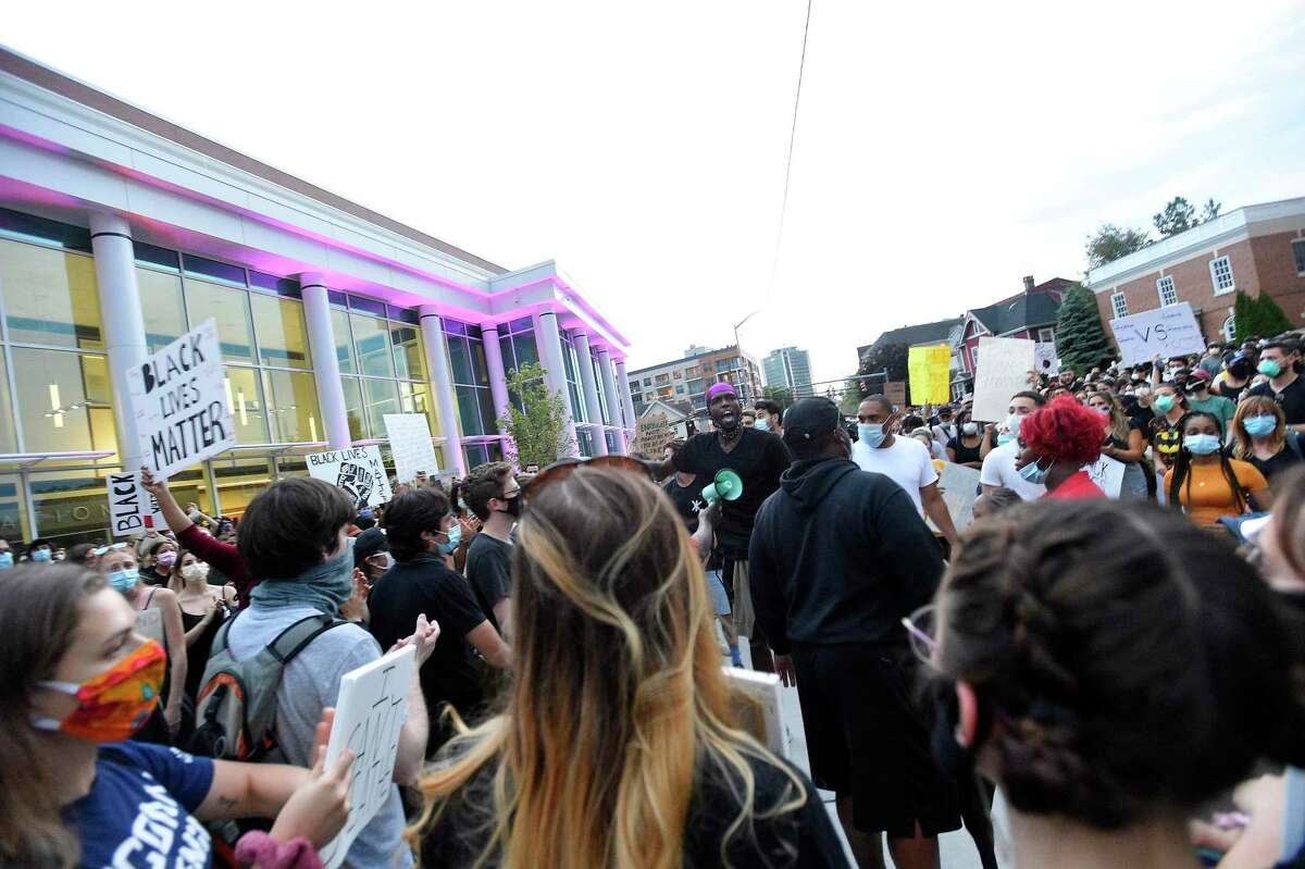 """Protesters shout """"I Can't Breathe"""" as they march on Wednesday in Stamford."""