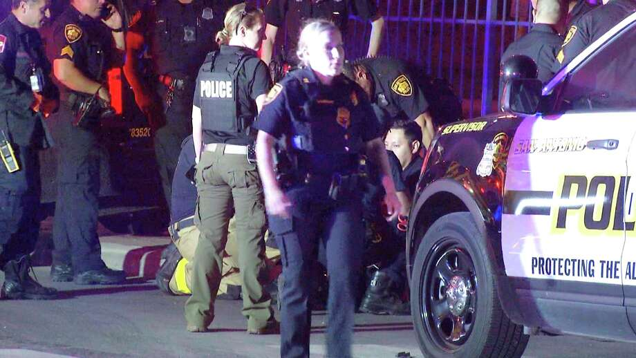 A San Antonio police officer was hospitalized after a two-vehicle crash downtown Wednesday night. Photo: Ken Branca