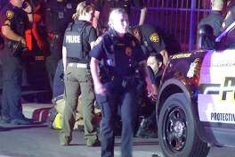 A San Antonio police officer was hospitalized after a two-vehicle crash downtown Wednesday night.