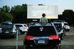 Patrons enjoy movies offered on three screens at Mansfield Drive-In Movie Theater in Mansfield, Conn., on May 26.
