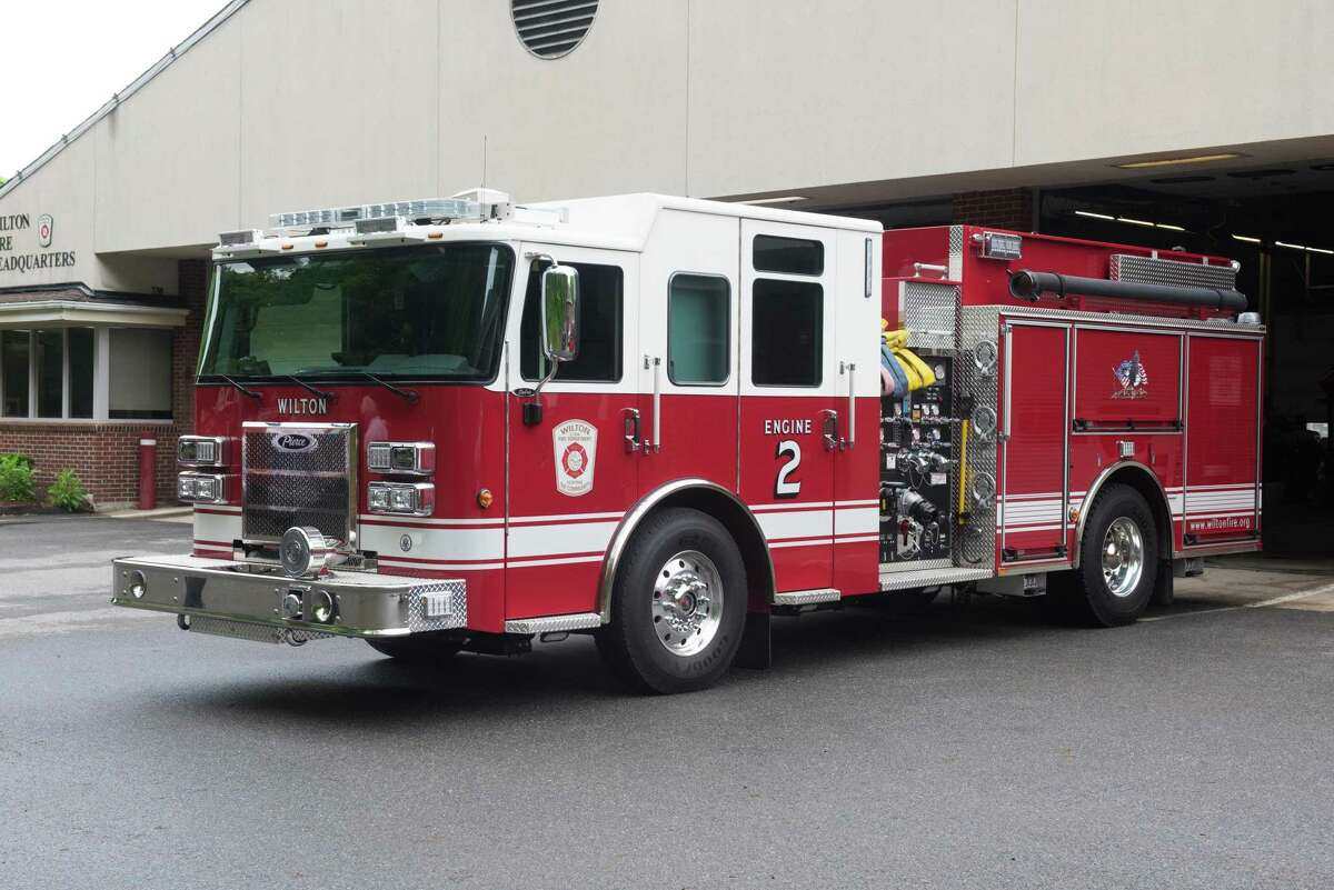 The Wilton Fire Department's Engine 2 is pictured during a previous year. The fire department, which protects the town's residents, gives them tips in this guest column about how they can dispose of ashes safely after having a safe fire.