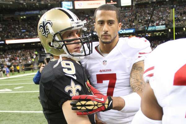 NEW ORLEANS, LA - NOVEMBER 17: Colin Kaepernick #7 of the San Francisco 49ers embraces with during Drew Brees #9 of the New Orleans Saints prior to the game at the Superdome on November 17, 2013 in New Orleans, Louisiana. The Saints defeated the 49ers 23-30. (Photo by Michael Zagaris/San Francisco 49ers/Getty Images)