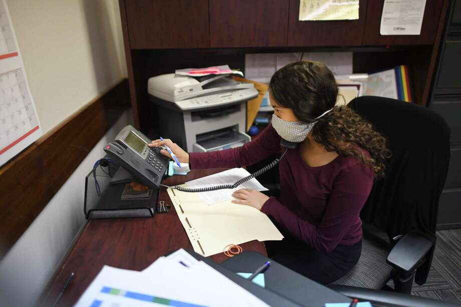 Andrea Valadez, who is almost done with a master's degree in public health from UT Health San Antonio, has been volunteering as a contract tracer for San Antonio Metro Health. She works the phones on Thursday, May 7, 2020. Photo: Billy Calzada / San Antonio Express-News / ***MANDATORY CREDIT FOR PHOTOG AND SAN ANTONIO EXPRESS-NEWS /NO SALES/MAGS OUT/TV