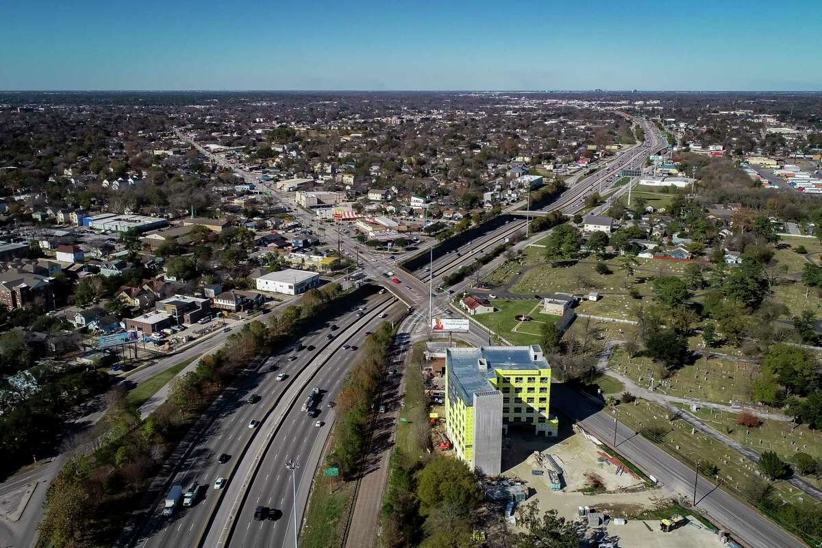 A new Holiday Inn being built along Interstate 45 sits next to Hollywood Cemetery at North Main Street in Houston, seen on Jan. 7, 2020. The impending Interstate 45 project will drastically change the area, where many businesses along the freeway will be acquired.